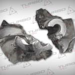 Koło kompresji rozerwane na skutek przekroczenia wytrzymałości mechanicznej materiału - zbyt wysoka prędkość obrotowa wirnika turbosprężarki.